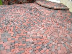 These simple brick pavers would highlight an old-fashioned country home beautifully. Love the artistry in the layout. From Paverstone Design Group in OH. More about how to use brick and pavers successfully here http://www.landscapingnetwork.com/patios/brick.html