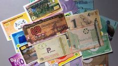 """Paying with 'kisses' as Brazil's social currencies spread..."""