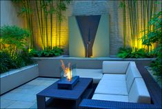Courtyard Designs for The Exterior of A House: Enchanting Courtyard Garden Design With Contemporary Fireplace Also White Sofa And Unique Coffee Table ~ sagatic.com Gardens Inspiration