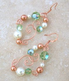 Copper Wire/ Pearl & Peridot Swarovski Crystal Earrings CE116. $38.00, via Etsy. Beautiful colors