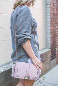 Blogger, Ashley Pletcher, shares her Fall transition pieces with the cozy grey sweater and beautiful pink Rebecca Minkoff bag