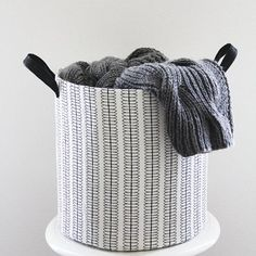 Keep unruly winter accessories in line with a handsome patterned-fabric storage basket — or explore dozens of other ways to get your gear under control via Etsy's curated page of storage and organizing finds. #etsyhome