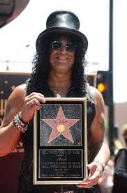 Slash reseives his star at Hollywood Walk of Fame. (just outside Hard Rock Cafe)