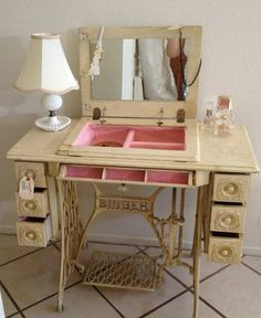Vintage old singer sewing machine repurposed into pretty pink and white vanity, add mirror: Upcycle, Recycle, Salvage, diy, thrift, flea, repurpose, refashion! For vintage ideas and goods shop at Estate ReSale & ReDesign, Bonita Springs, FL