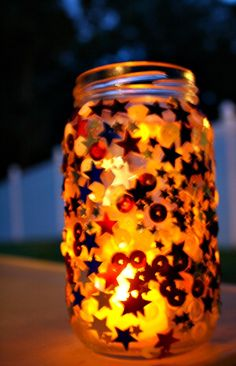 Easy Jar Candle Craft and Discover and Explore 4th of July Collection - and is that in a spaghetti jar or something similar?  Cool.  Recycling.