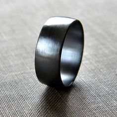 Alex likes these dark wedding bands, but wants something less plain... but still subtle. Keeping my eyes out!