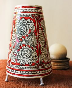 This beautiful leather lampshade with floral motifs in red and white is a work of brilliant leather artistry of the tribal women of Anantpur village in Andhra Pradesh/ OUATT Market