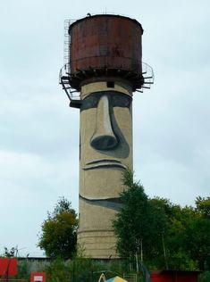 Easter Island style Moai grafitti on water tower.