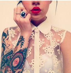 Beautiful girl piercings rings tattoos lace top