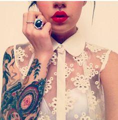 Beautiful girl piercings rings tattoos lace top