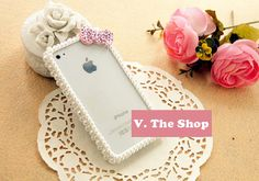 A pearl-encrusted iphone case.  Minus the the sparkle bow, it's very Charlotte! $45.00