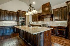 These beautiful rich cabinets make this gorgeous kitchen pop! #ShaddockHomesTX #Kitchen #KitchenDesign