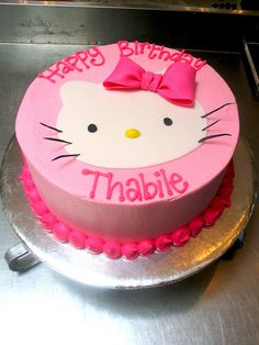 Wicked chocolate cake iced in soft pink butter icing decorated with fondant Hello Kitty face & piped message by Charly's Bakery, via Flickr