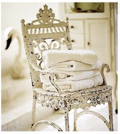 Love this old white chair with towels for bath - Better Homes and Garden ~