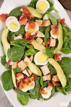 If you're one of the many cutting carbs from your diet right now, this Low Carb Spinach Salad w/ chicken bacon, eggs and avocado is just what you need!