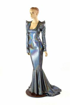 This glamorous dress has long, sharp shoulder sleeves, a scoop neckline, and a figure flaunting wiggle dress cut, that gets narrower below the hips for a very s
