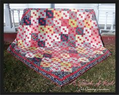 A Touch of Red Quilt by Jo Kramer 98″ x 98″ quilt-The quilt is a giant and finishes at 98″ x 98″ but it only uses two jelly rolls of Sweetwater's Reunion fabric line