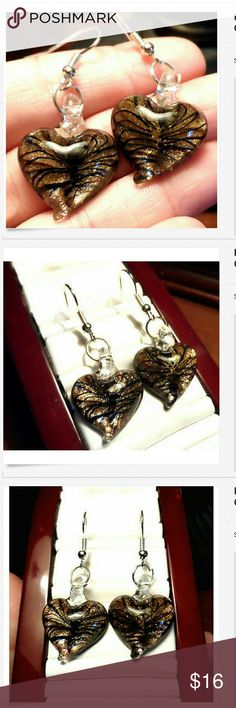 """MURANO GLASS Heart Earrings Gold Black Dangle Individual monitors may display slightly different colors or hues...?  NEW ON CARD-  MURANO GLASS Earrings  EARRINGS: approximately 2""""x.75"""" CLOSURE: Fish Hook? Costume jewelryBlown glass Heart design with sparkling Gold embedded Dangle drop style Black and Gold in colorNEW NEW NEW! Check out my other Jewelry Items! unbranded Jewelry Earrings"""