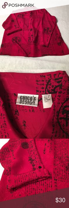 Chico's Silk Shirt/Jacket Beautiful deep red silk (100%) with damask-weave pattern of leaves overprinted with black Asian characters. Long sleeves have optional button tab. Back pleat. Tunic length; center back neckline to hem is 33 inches long. Chico's Tops Blouses