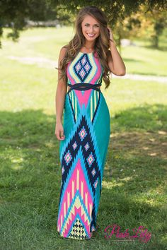This fitted aztec maxi is perfect for your next girls night out or night at the club! There's cutouts along the side, back, and middle of the dress for a trendy look, while the bold neon pink, yellow, teal, blue, and navy pattern will stand out in a crowd!