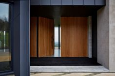 SJB designed this modern house in Red Hill, Australia Modern Entrance Door, Modern Front Door, House Entrance, Entrance Doors, Timber Front Door, Timber Slats, Wooden Cladding, Front Doors, Gate Design