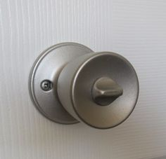 How to spray paint crappy old door knobs with a fancy shmancy new finish (brushed nickel in the photos).