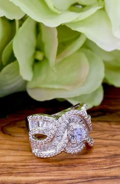 Magnificent sparkle with this white stone, white tone ring. Just beautiful with the greens and browns behind it! Dare to rock a rock like this!