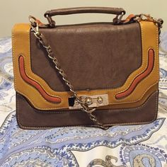 Small Melie Bianco Purse This purse is perfect for a night out! It's compact and structured look goes perfect with any sweater and boots on a chilly evening! Cross body strap allows for easy carrying! Melie Bianco Bags Crossbody Bags