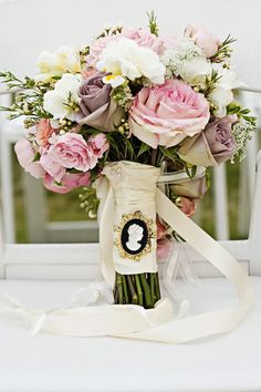 Love the cameo on the bouquet. I'm pretty sure my mom has a blue one. Hmmm... might be perfect for my something borrowed (and blue). #cedarwoodweddings