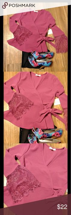"""Meraki wrap around top🌷🌷New Listing Beautiful wrap around top with a slight peplum to it. Gorgeous sleeve's, with beautiful lace hem. It's a pretty purple, maroon pinkish color. Depending on how you see it. I paired it with shoes that have bright pink in it and it looks great💗💗 Chest closed/wrapped 34"""" length 21"""". Length to end of lace is 23"""" Never wore, too tight across chest. New. Meraki Tops"""