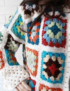 """Watch Maggie review this beautiful Granny Square Coat Crochet Pattern! Design By: Maggie Weldon Skill Level: Easy Size: To fit chest measurement: 32"""" (36"""", 40"""", 44"""", 48"""") Pattern is written for Small,"""