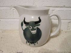 Vintage Scandinavian modern Arabia Finland, Bull / Cow with Utter milk jug designed by Kaj Franck in 1967. - $40    This vintage and charming green and black Bull / Cow with Utter milk jug designed by Kaj Franck in 1967 is in good shape given it's age.     This highly collectible jug does show signs of use with two small chips on the base rim as shown in photos. The chips are not noticeable when set down and only noticed when you turn the jug upside down.