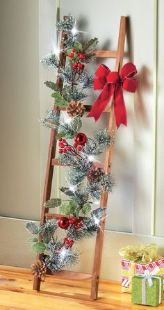 Hung on a wall or propped next to the fireplace, this charming ladder is a colorful addition to your holiday décor. Description from collectionsetc.com. I searched for this on bing.com/images #outdoorholidaydecorations