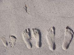 family sand footprints
