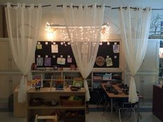 **Sticks to hold up curtains, define the space. The following photos are from the classrooms at my school. My colleagues have created such glorious spaces.  I am going to post a series of elements. Today's element is lighting.  There are two main types of lighting in today's photos – twinkle lights and lamps.  Twinkle lights add a layer of magic and wonder.  It …