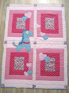 Handmade baby quilt with appliqued giraffe and hearts  by Mippoos, €125.00