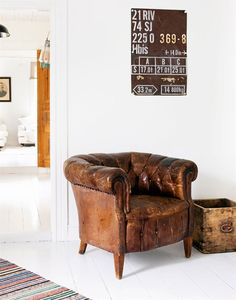 old tufted leather chair