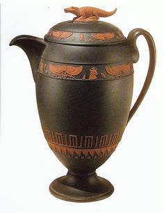 Black basaltes Egyptian-taste coffee pot with rosso antico decoration, the finial formed as a crocodile, late 18th century.