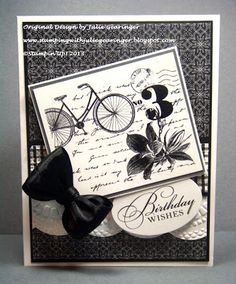 """Postage Due, Watercolor Trio (both MDS)  Ink: Printer Ink- Black  Cardstock: Whisper White, Basic Black, Designer Series Paper- retired Night and Day, retired Background Paper  Accessories: Big Shot™, Delicate Accents (Lace) and Square LatticeTextured Impressions™ Embossing Folders, XL Oval Punch, 5/8"""" Black Satin Ribbon"""