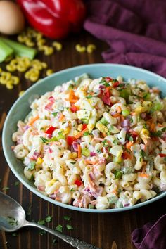 The best summertime macaroni salad! Just like what you remember eating as a kid but here it's made a little healthier with Greek yogurt in the dressing. It's layered with colorful veggies and sure to satisfy!