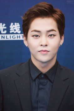 Xiumin. His eyes are straight up reflective!!!!!