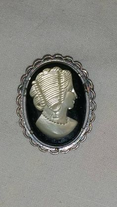 Check out this item in my Etsy shop https://www.etsy.com/listing/216677761/vintage-krementz-cameo-pin-from-the