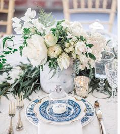 2 light marble vases spilling with lush arrangements of cream hydrangea, ivory spray roses, dusty blush roses, blush astilbe, hints of trailing jasmine vine, and ivory roses