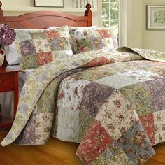 Lend a touch of country-chic style to your master suite or guest room with this lovely cotton quilt set, showcasing a patchwork motif and eye-catching palette.