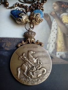 St George and the Dragon crown assemblage necklace, upcycled antique knight, religious reinvented medals jewelry devotional saints medallion Funky Jewelry, Unusual Jewelry, Antique Jewelry, Vintage Jewelry, Saint George And The Dragon, Dragons Crown, Alternative Style, British Fashion, Quirky Gifts