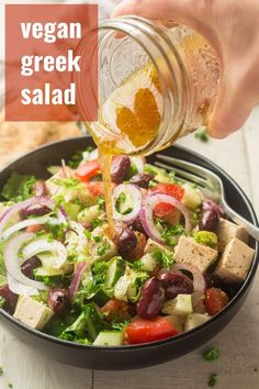 Crispy fresh lettuce, juicy tomatoes, tomatoes, and tangy tofu feta cheese go into this delicious vegan Greek salad. Easy to make and perfect as a light meal or side dish! #veganrecipes #vegansalad #greeksalad Vegetarian Menu, Vegan Lunch Recipes, Easy Salads, Healthy Salad Recipes, Delicious Vegan Recipes, Veg Recipes, Vegan Food, Dinner Recipes, Cooking Recipes