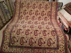 "This featured carpet is an Antique Persian Qum with the Boteh motif. Size: 6'6"" by 4'5"" Age: About 70 years"