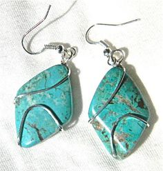 Gorgeous Diamond shaped Torquoise stone earrings silver wire wrapped. $30.00. Please go to http://www.miselaynesjewels.weebly.com to see these and the matching necklace as well as my other jewelry creations.