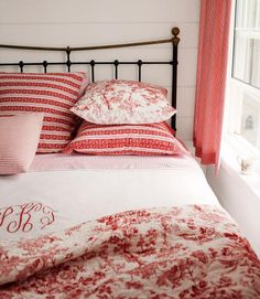 Lively Ways to Use the Color Red Soften a wrought-iron bed by decorating with a mixture of red toile and ticking linens. Looks so cozy!Soften a wrought-iron bed by decorating with a mixture of red toile and ticking linens. Looks so cozy! Red Bedroom Decor, Bedroom Colors, Bedroom Ideas, Bedroom Designs, Bedroom Furniture, Furniture Sets, Wrought Iron Beds, Red Bedding, Toile Bedding