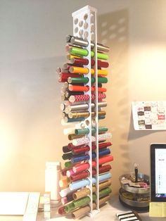 See how to make a DIY wooden vinyl storage tower to hold all of your rolls of vinyl